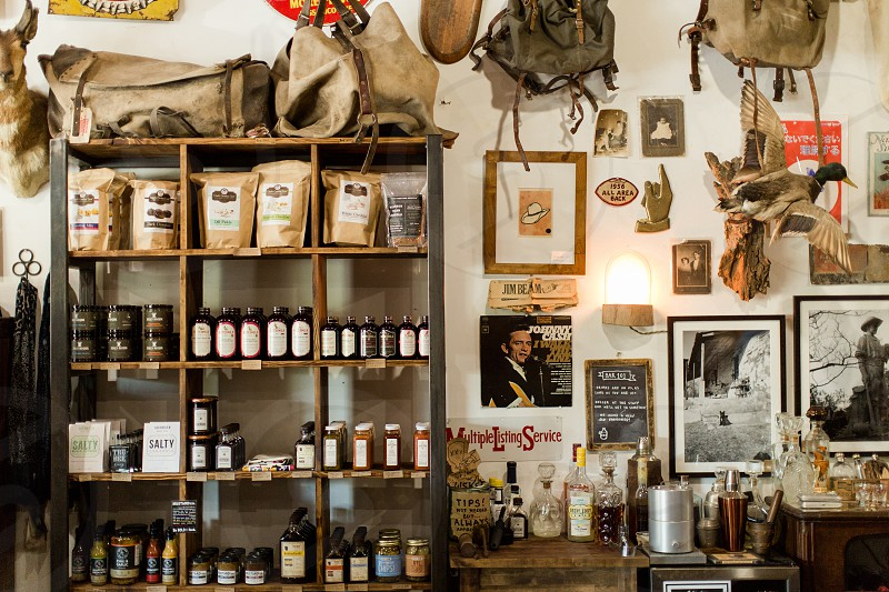 Mercantile small goods goods for sale items detailed shots store leather metals candles in store antiques photo