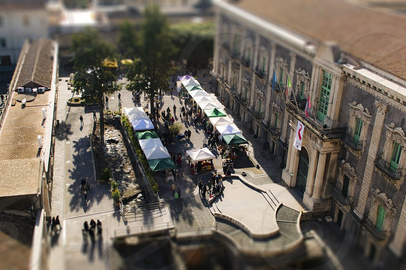 Market stalls in the courtyard of the Benedictine Monastery in Catania Sicily photo