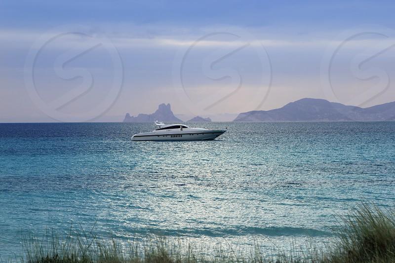 silver turquoise Illetes Formentera sea sunset magic evening light  photo