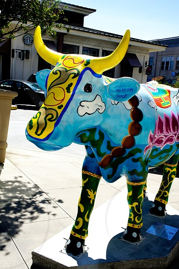 Painted cow statue photo