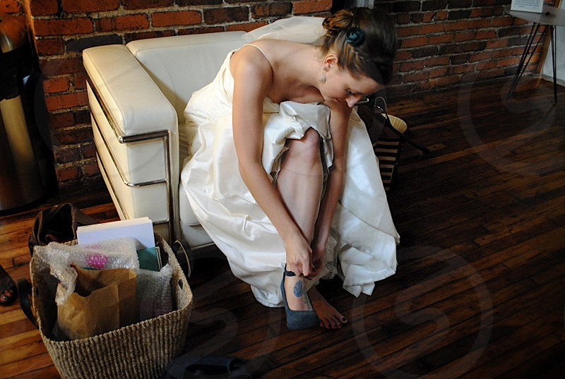 bride putting on shoes photo