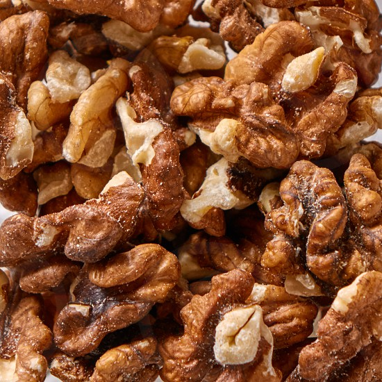 Texture of natural walnuts background. Natural organic food for diet vegetarian eating. Top view. photo