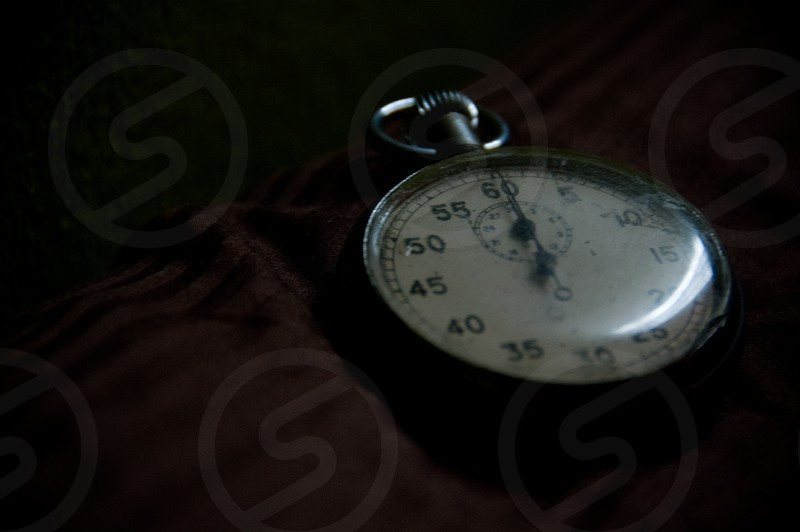 A stopwatch on a dark tablecloth. photo