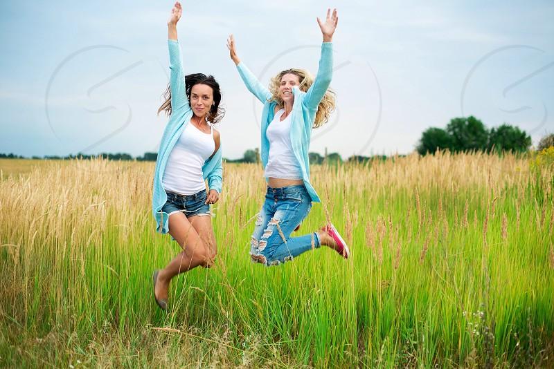 Modern friends girls happy funny stylish field joy cute love sky photo