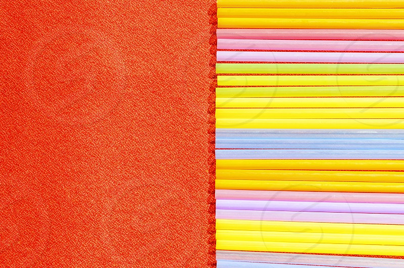 Colourful straws red background photo