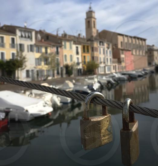 Two love locks on a bridge in Port De Martigues France photo