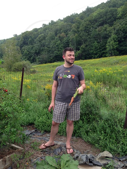 Man with Carrot in Garden in the Berkshires photo