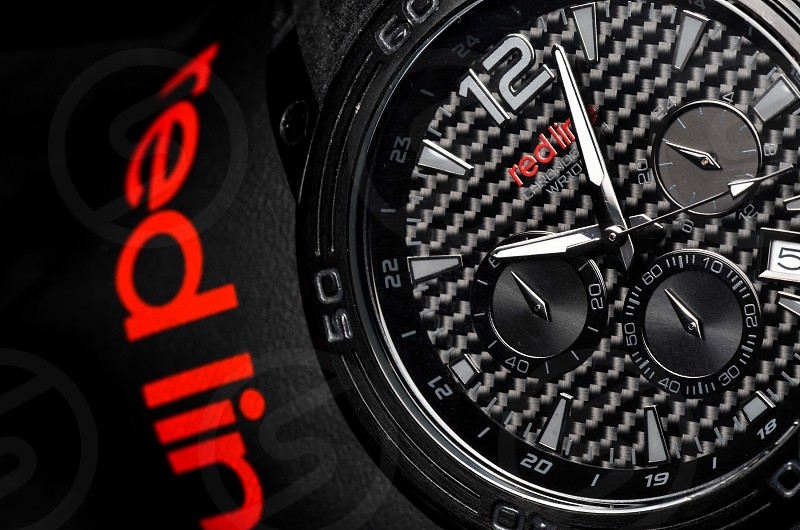 close-up photography of Red Line chronograph watch at 11:03 photo