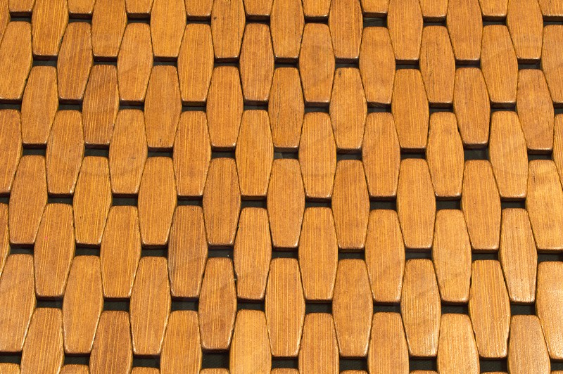 Wooden tile pattern in a floor mat as seen from above. photo