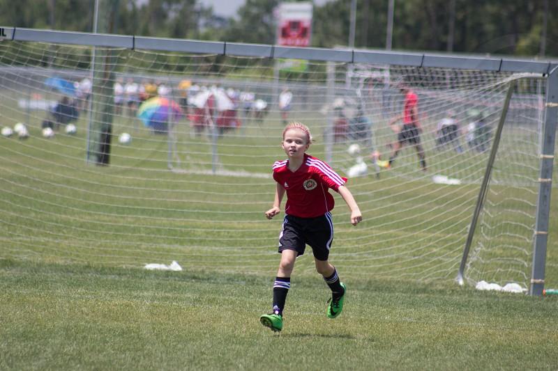girl soccer player on goal photo