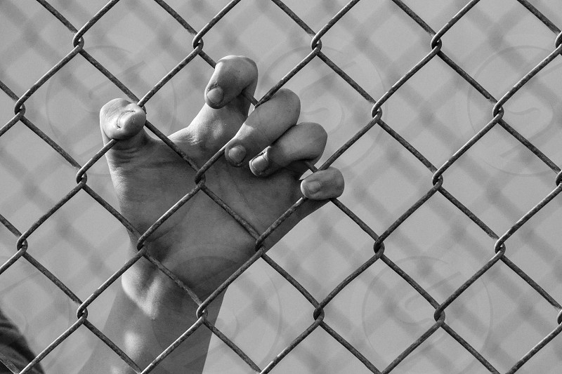 hands on chain link gray scale photo photo