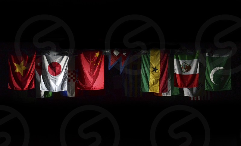 World Country Flags Many Hanging against black background Pakistan Mexico Ghana Nepal China Japan Vietnam photo