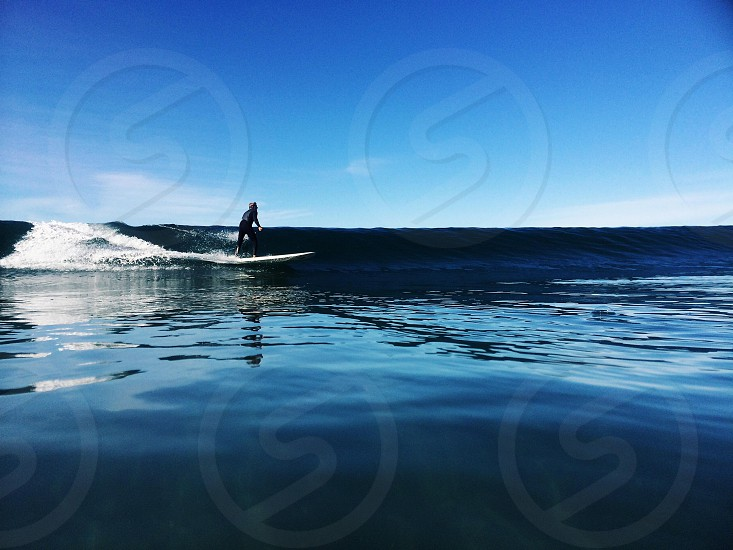 man surfing view photo
