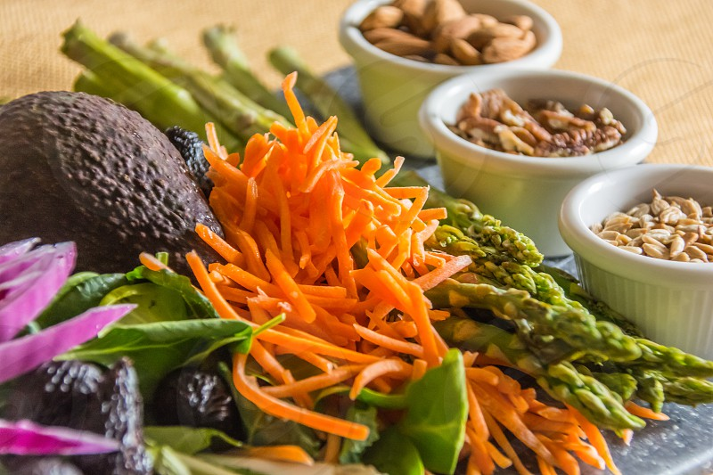 healthy food avocado carrot sunflower seeds pecans almonds asparagus onion fig spinach photo