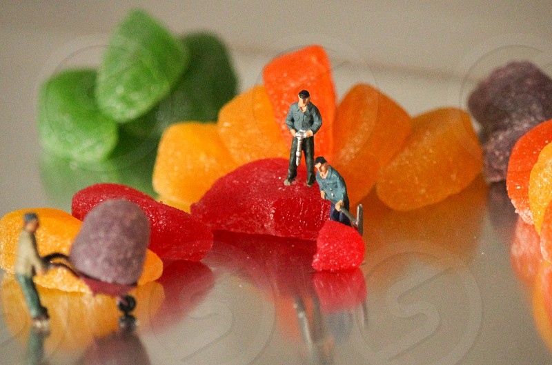 miniature human toy on jelly beans photo
