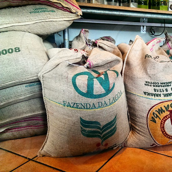 A few bags of coffee from Brazil on the floor photo