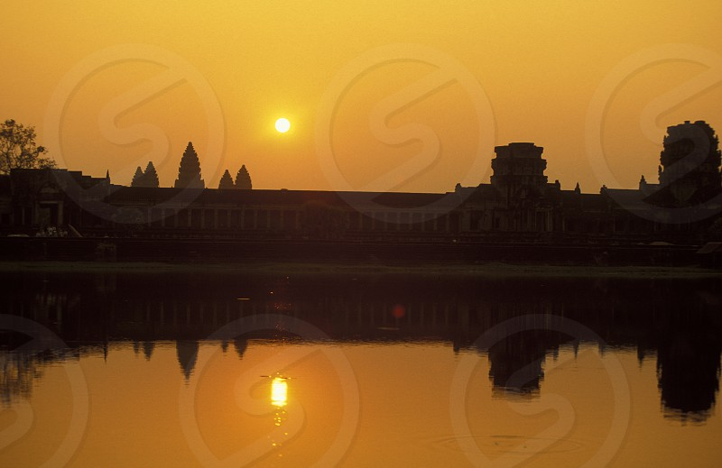 the angkor wat temple in Angkor at the town of siem riep in cambodia in southeastasia.  photo