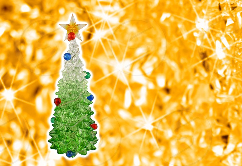 Golden christmas background with a tree. Simple Christmas card. Christmas decoration on a golden background. Christmas tree with a star photo