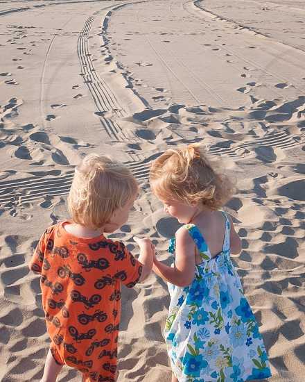 Holding hands at the beach photo