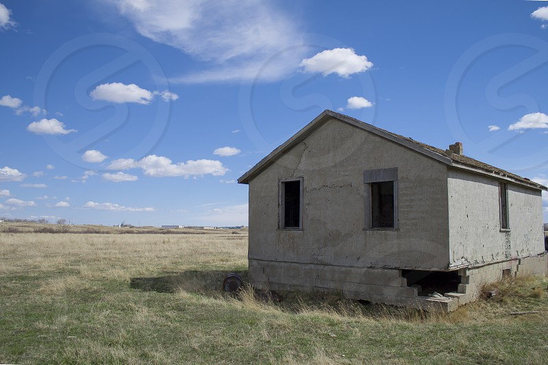 Abandoned home on the outskirts of town on a clear spring day. photo