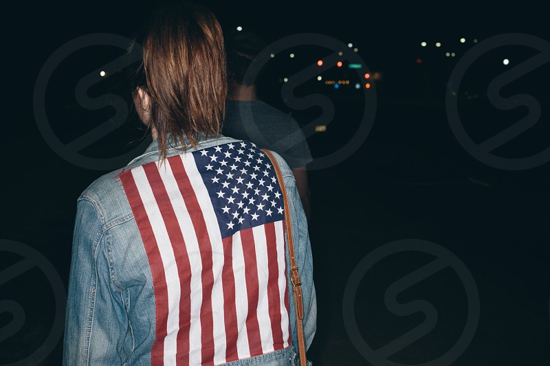 woman wearing blue denim jeans with usa flag print photo