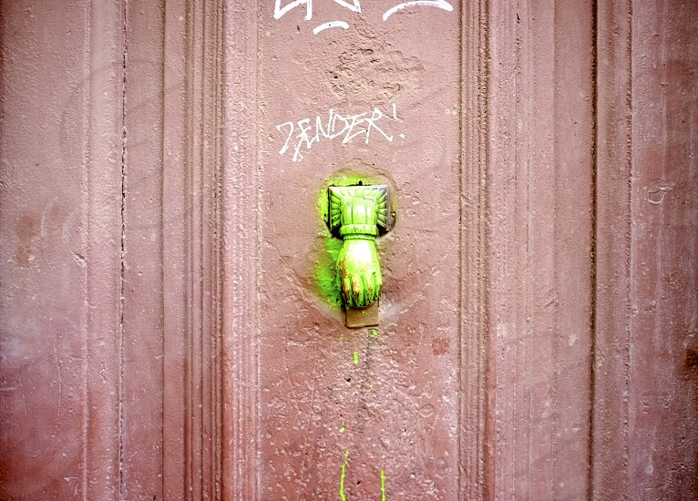 green wall mounted hand figure photo