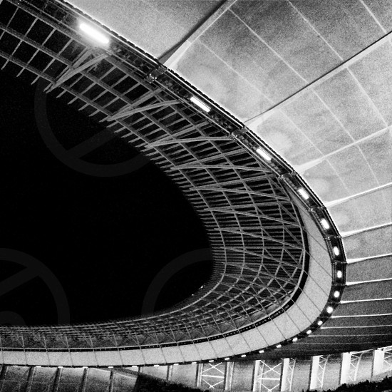 Stadium roof. curves cape town black and white B&W grain grainy photo