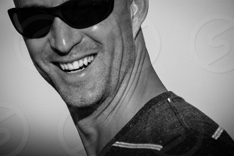 man laughing sunglasses smiling happy striped shirt black and white handsome natural photo
