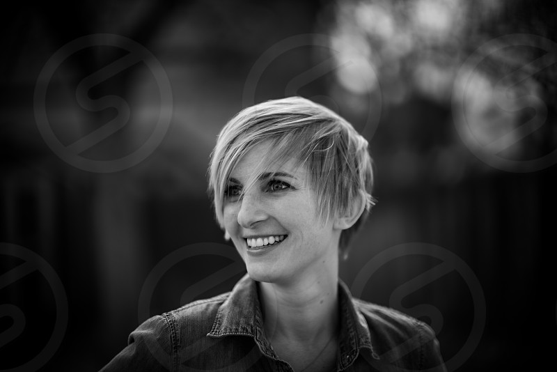 photo of smiling woman with short hair and collared shirt photo