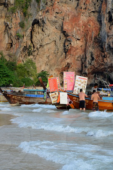 A Thai Fast Food Shop in a Woodboat at the Hat Phra Nang Beach at Railay near Ao Nang outside of the City of Krabi on the Andaman Sea in the south of Thailand.  photo