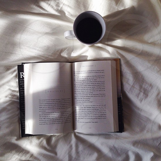 Open book and coffee photo