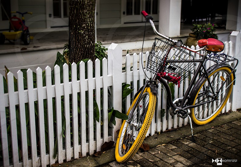 Vibrant and peaceful capture of a bicycle representing the slower pace of life in the beautiful community of Seaside Florida.  photo