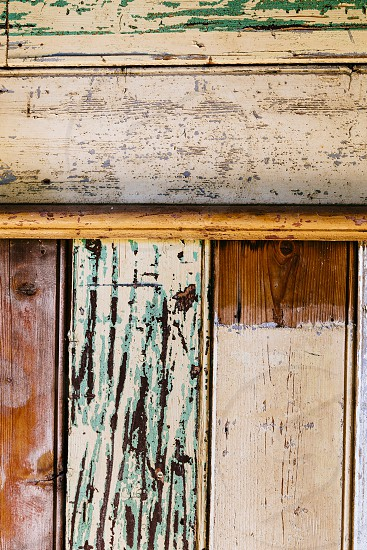 painted textured timber wood patina worn abstract pattern panel photo