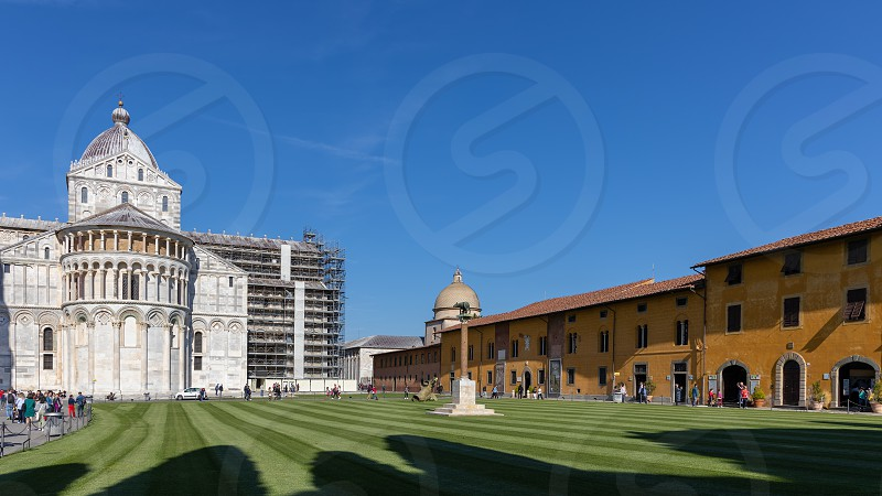 PISA TUSCANY/ITALY  - APRIL 18 : Exterior view of the Cathedral in Pisa Tuscany Italy on April 18 2019. unidentified people photo