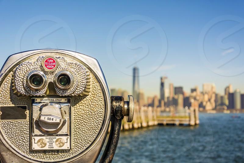 Binoculars facing new york skyline photo
