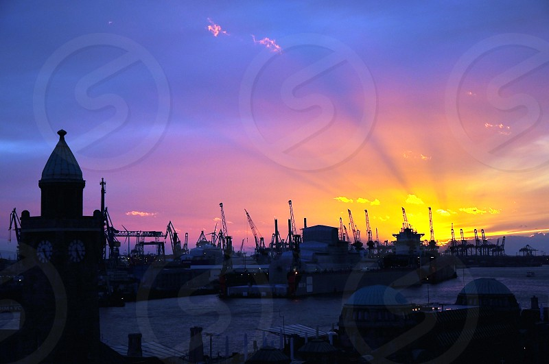 sunset colors at Hamburg harbour Germany photo