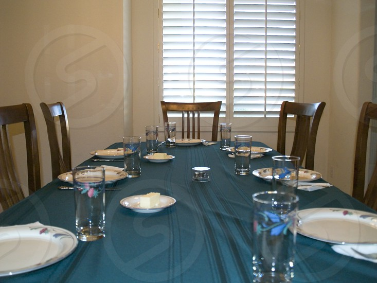 A dinner table in a home set and ready for food to be served. photo