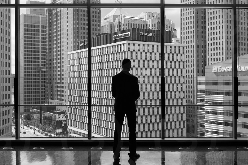Business Traveler looking out to downtown Detroit photo