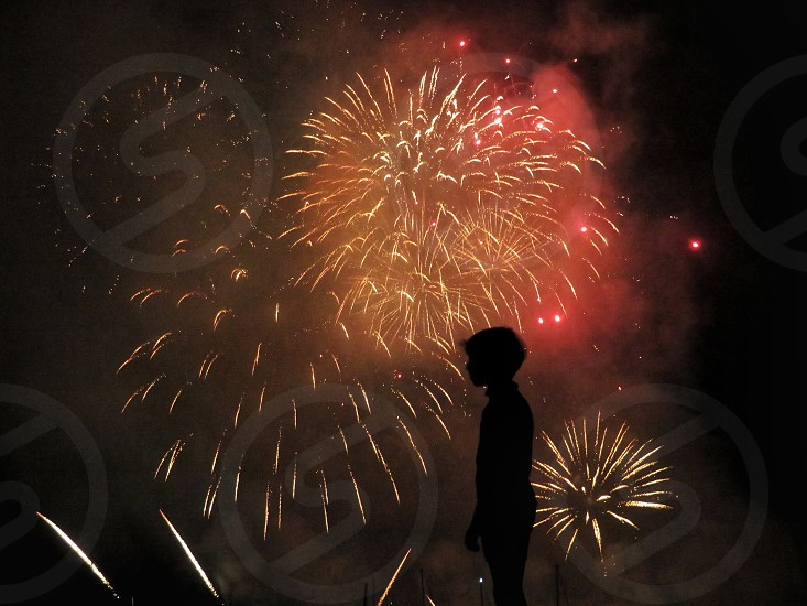 child gazing fireworks photo