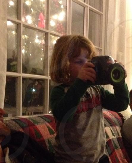 girl taking photo photo