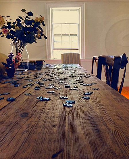 Perspective angle on puzzle pieces on a wooden table photo