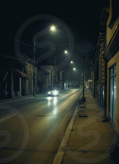 Outdoors of a small Balkan town during night.  photo