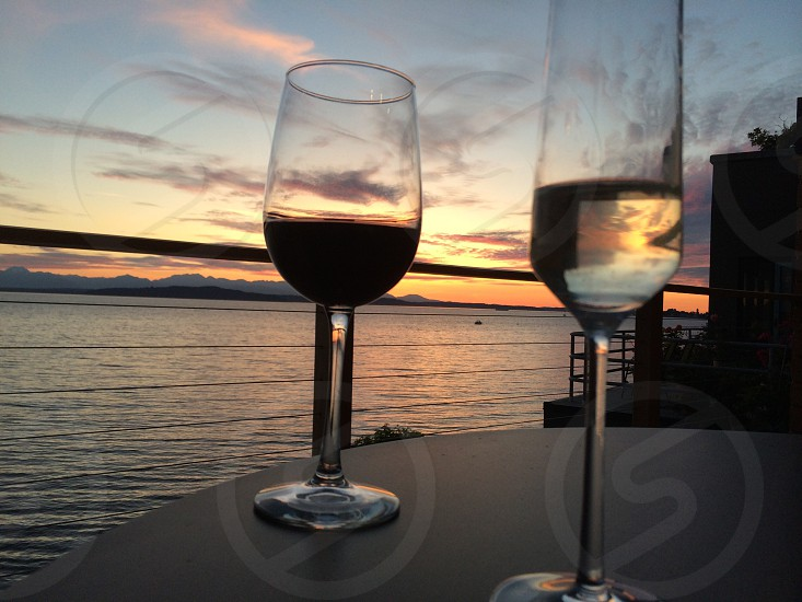 Champaign and wine sunset Puget sound photo