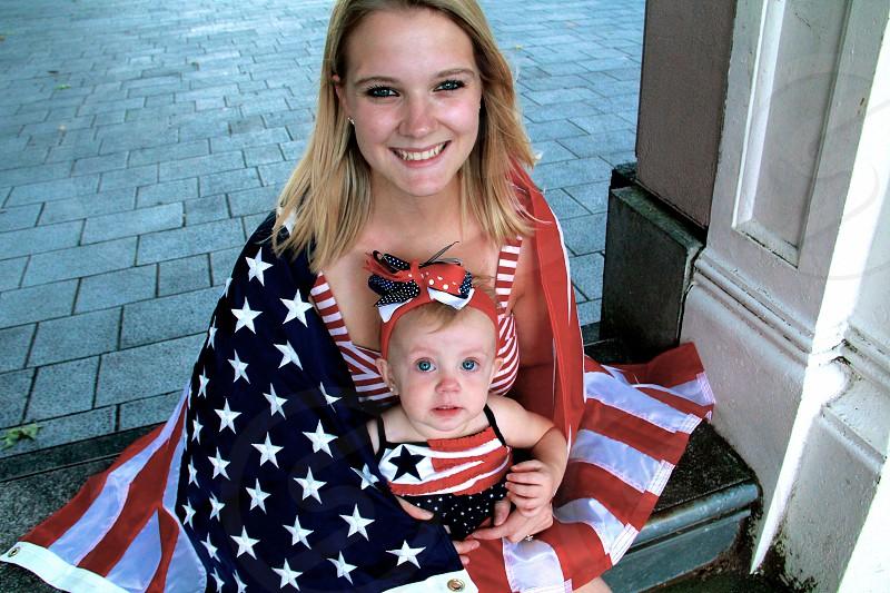 woman hugging baby photo