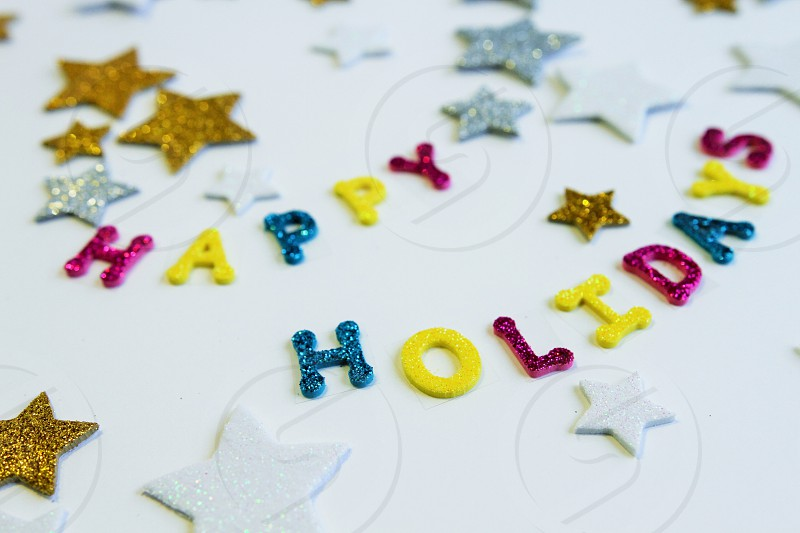 happy holidays glitter letters starts gold silver colorful greeting card photo