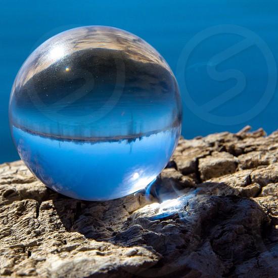 Glass ball in front of a lake near Denver Colorado photo