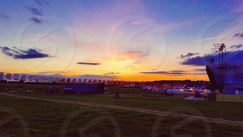sunset view over green grass photo
