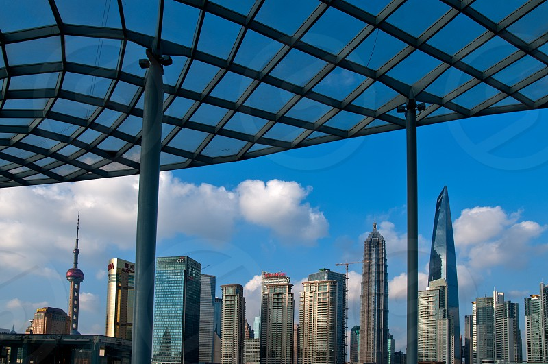 shanghai pudong view from puxi new bund on a sunny day with white clouds and blue sky photo
