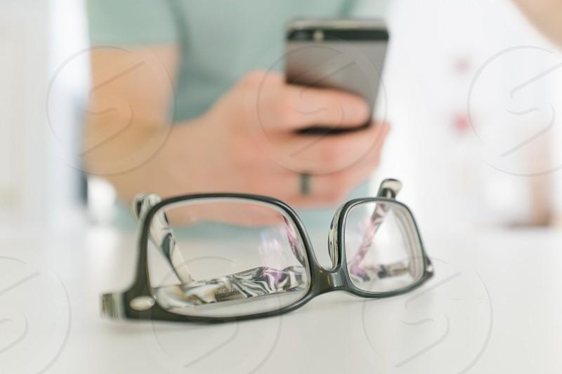 black rimmed eye glasses on table photo