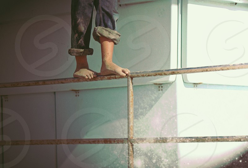 human feet on top of metallic hand rail photo
